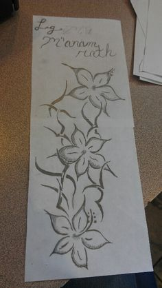 """Designed it myself. Each flower is for me and my two sisters. The words mean """"let my soul flourish"""". It's gaelic"""