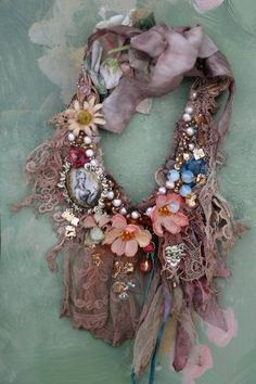 Experimental necklace in my original style,-series with old laces& hand embroidery inspired by antique textile and old paintings. Shades of beige, sand, blush, peach..This shabby chic detailed neckpiece is made of wide array vintage and antique textiles. The antique laces are from my