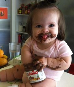 This little girl knows the right way to eat Nutella.