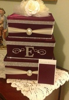 Wedding card box holder by Thatssolovely on Etsy  too ornate, but like the ribbon and three box thing