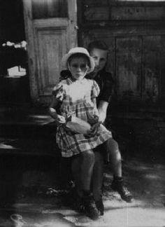 "During a roundup for deportation in eastern Poland in 1942, Gitta Rosenzweig—then three or four years old—was sent into hiding. She ended up in a Catholic orphanage. In 1946, Ida Rosenshtein, a family friend and a survivor, learned of the child's whereabouts and sought to claim her. After denying that it held a Jewish child, the orphanage relinquished custody after Ida recognized Gitta and a local Jewish committee paid a ""redemption"" fee. Gitta is pictured here on the day she left the…"