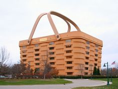 Longaberger basket company headquarters is shaped like a giant basket. Not just any old basket, though. It's a Longaberger Medium Market Basket that's been blown up to 160 times its normal size. The seven-story atrium has heated handles that prevent ice formation, and two 725-pound gold leaf Longaberger tags.
