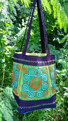 A personal favorite from my Etsy shop https://www.etsy.com/sg-en/listing/260192433/hmong-embroidery-sapa-hilltribe-handbag