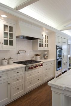 White cabinets and a white cararra top - this does work and is beautiful - by Strening Architects