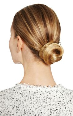 gold french hair pins in a low bun