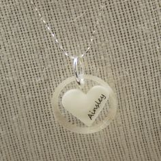 Breastmilk Pendant Necklace - Hollyday Designs ... this pendant is made from your OWN breastmilk. She also has a kit to make your own keepsake. http://www.hollydaydesigns.com/breast-milk-pendant-with-name/