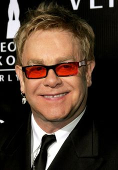 Elton John (Reginald Kenneth Hercules Dwight)