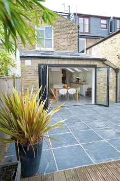 Hire interior designers and builders London for loft conversions and house extensions, such as side return kitchen extensions for Victorian terraced houses. Get an instant online quote and see how you can benefit from a side return extension. House Styles, Roof Light, House Design, Bifold Doors, New Homes, House Extension Design, Terrace House, Loft Conversion, Ideal Home