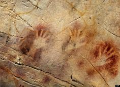 The world's oldest cave art forms were discovered in El Castillo Cave in Cantabria, Spain. The earliest dates were a minimum of 40,800 years ago for a red disk, 37,300 years ago for a hand stencil, and 35,600 years ago for a club-shaped symbol. The red disk is at least 4,000 years older than anything previously found in Europe.
