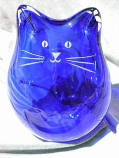 Cobalt blue blown glass cat  http://www.arcreactions.com/areospace-website-design-3/