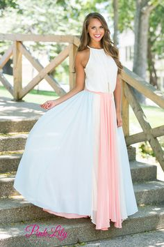 This playfully pastel skirt is perfect for spring or summer! Featuring cornflower blue, peach, and light beige, this flowy skirt is so easy and breezy to wear! It also has a peach elastic band around the waist and lightweight fabric that will stay cool all summer long!