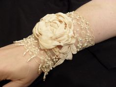 Lace cuff with silk rose by lambsandivydesigns.com, via Flickr