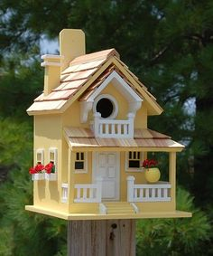 Share your outdoors with friendly avian neighbors by placing the Home Bazaar Yellow Backyard Bird Cottage in your bird garden. The familiar architectural elements create a realistic shelter, while the white color brings a bright hint to your yard. The tall shape mimics a two story house, while the pitched roof, wraparound porch, and faux door and windows all evoke elements seen on homes throughout neighborhoods. ~ JacobsOutdoor