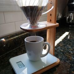 Barista alert! we can customize the base of this beautiful stand to fit perfectly your scale. Just select the personalize button and let us know the size you need.  Set Includes: - Adjustable height Coffee pour over dripper Stand. - V60 Hario Coffee Dripper, size 2, plastic.  - 5 Hario Paper filters. - Care card with instructions about how to take care of it. Coffee Pour Over Stand, Coffee Stands, Coffee Set, Coffee Ideas, Tiny Powder Rooms, Coffee Dripper, Coffee Is Life, Wood Patterns, Mineral Oil