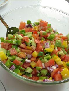 Israeli Salad    simple to make....tomatoes, cucumbers, onion, bell peppers, lemon juice, olive oil, salt