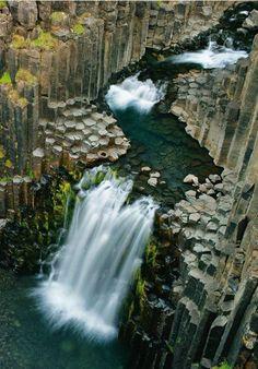 Litlanesfoss, Iceland: The waterfall cross-sections an ancient lava flow.