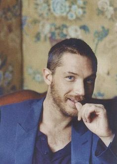 Oh my goodness, Tom Hardy with a background of vintage floral wallpaper!!! I just died. @Kaleigh Parsons