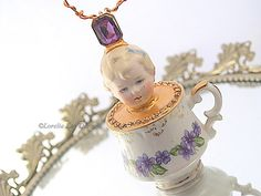 Juliette Teacup Ornament  Hanging Art Doll Assemblage China Teacup Mixed Media Doll Sculpture by loreliekaydesigns on Etsy https://www.etsy.com/listing/234776978/juliette-teacup-ornament-hanging-art