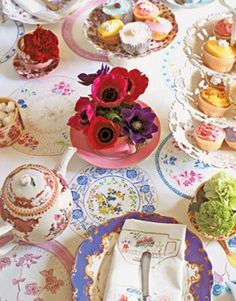 Brides Magazine: Wedding Wonderland.  Mismatched china with multitude of hues and patterns for a haphazard look.