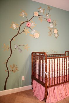I love the wall in this nursery.  They glued silk flowers to the tree...can you imagine if they added ribbons and other embellishments?  So gonna have to do this....