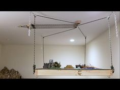 This video explains the process of building a table that raises to the ceiling, to save space or for the pure enjoyment of it. Since it has been a while sinc. Lift Table, Build A Table, Garage Hoist, Pully System, Ceiling Bed, Bike Storage Solutions, Tool Storage, Garage Ceiling Storage, Hanging Beds