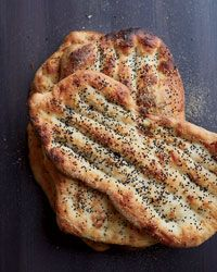 Persian Flatbread Nan-e barbari is a classic Persian flatbread that gets crisp and golden in the oven, thanks to roomal, a flour paste that's spread over the bread before it' Jessamyn Rodriguez likes to serve it with feta and olives. Wine Recipes, Indian Food Recipes, Cooking Recipes, Dessert Recipes, Good Food, Yummy Food, Flatbread Recipes, Eastern Cuisine, Vegan Bread