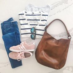 Madewell t-shirts with Adidas shoes and a Frye hobo bag