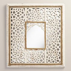 Our hand-carved mirror is inspired by jalis, the intricate perforated screens found in traditional Indian architecture. Painted white and artfully distressed, it has the look of well-traveled antique.