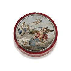A GILT-METAL-MOUNTED PURPURINE BONBONNIERE SET WITH AN ITALIAN MICROMOSAIC  THE MICROMOSAIC, ROME, CIRCA 1810   Circular red purpurine box, the independent cover set with a micromosaic plaque depicting the three Fates, Clotho, Lachesis and Atropos with Father Time, within silver mount  3 in. (79 mm.) diam.   An associated paper is inscribed 'Snuff box given by Alexander Emperor of Russia, to Lord Castlereigh' (sic)