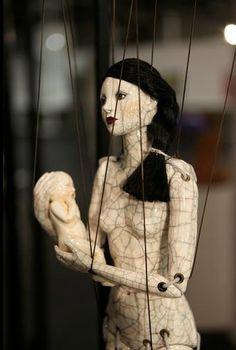 Hijiri Yahagi's series of life-sized ceramic figure puppets boast cracked surfaces symbolizing the hardships of this life journey.