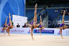 Belaurs's team performing the clubs routine during the FIG Rhythmic Gymnastic World Cup series Pesaro 2014.