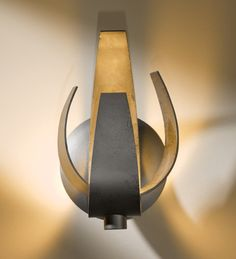 Hubbardton Forge 206501 Corona Direct wire wall sconce in Dark Smoke finish with clear with frost glass -  Suitable for Damp Locations. Hubbardton Forge is hand-forged in Vermont, USA. Over 200 artists and craftspersons create each of these wrought-iron pieces with tools from a bygone era; hand-forging raw metal into functional art lighting. Brand Lighting Discount Lighting - Call Brand Lighting Sales 800-585-1285 to ask for your best price!