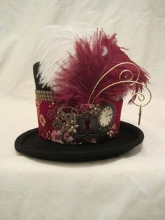 Mini top hat, to with the with maroon and black skirt of your choice.