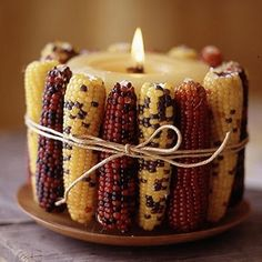 Thanksgiving centerpiece with Indian corn. Save the ears of corn after Thanksgiving is over, and use the kernels to grow your own ornamental Indian corn next year! Thanksgiving Crafts, Thanksgiving Table, Thanksgiving Decorations, Fall Crafts, Nature Crafts, Fall Table, Cork Crafts, November Thanksgiving, Thanksgiving Celebration