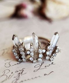 this is an awesome ring! diamonds, studs, rough cut. all time fave.