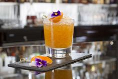 One Apricot - Zorokovich vodka muddled with fresh apricots, topped with crushed ice and edible flowers. Lobby Bar, Leading Hotels, Champagne Cocktail, Cocktails, Drinks, Covent Garden, Edible Flowers, Pint Glass, Vodka