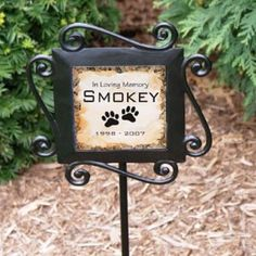"Personalized Pet Memorial Garden Stake is a beautiful memorial accent to any yard or garden. Your personalized pet memorial includes heavy duty wrought iron stakes which are 28"" high x 8.5""wide with a 4.25"" ceramic tile insert. Tiles may fade with weather and excessive sun exposure.  The words ""In Loving Memory"" and the paw prints are part of the tile.  You personalize with the pet's name and years. Ships out in 1 to 2 days. Item: PG6315 Price: $23.95"