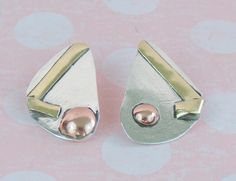 Sterling Silver Earrings accented with Brass and Copper.