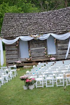 Outdoor wedding decor...have a rustic old barn or building for your outdoor wedding you want to make look neat...try drapping some sheer fabrics...great idea!