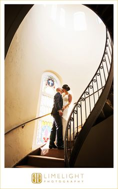 Sacred Heart Catholic Church, staircase, stained glass windows, bride and groom, wedding, limelight photography, www.stepintothelimelight.com