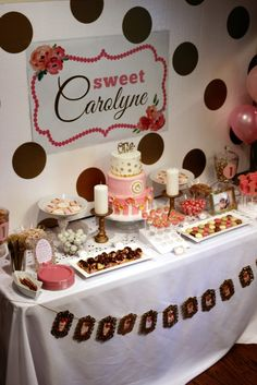Pink and Gold Floral First Birthday - love the gold decals on the party backdrop. Cute decor!