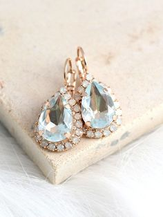 Aquamarine Earrings, Light Blue Earrings, Bridal Aquamarine Drop Earrings, Opal Drop Earrings, Light Azore Earrings, Swarovski Earrings  ♥IF YOU WANT THE BEST CHOSE THE ORIGINAL ♥ Top Quality Materials ♥ Excellent Customer Service ♥ Swarovski Authentications Tags ♥ Petite Delights is an Official SWAROVSKI® Branding Partner Official Swarovski Elements® Partner Made with real genuine high quality Austrian Swarovski ©Crystal . Our brand is legally licensed & authorized By Swarovski Company ...
