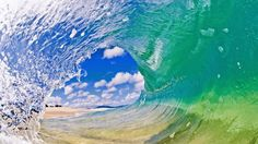 CRYSTAL BALL-- A surfer's view out of a shorebreak tube breaking in the crystal clear water of the North Shore. (Photo: Clark Little)