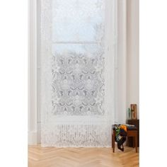 Islay Ivory Lace Panel A William Morris inspired ivory lace ready to hang with a slot top heading. Featuring 95% cotton and made on original Nottingham Lace looms in the Ayrshire, Scotland.