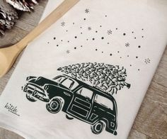 "Adorable, hand screen printed Retro Wagon with Evergreen Christmas Tree dish towel (1)...Perfect for your Winter OR Holiday kitchen!   100% Cotton, washable flour sack dish towel measures approx 27""x28"" - Print measures approx. 7""x9.5"" - and is super absorbent  - making it not only the cutest towel in your kitch - but the most usful as well!  Print is in Deep Pine Green & with quiet winter snow falling around it, on one natural white towel.   Comes packaged in very sweet natural cardstock…"