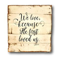 """We Love Because He First Loved Us Wood Sign / 1 John 4:19 Sign / Wedding Gift / Bible Verse Wood Wall Hanging. 1 John 4:19 Bible Verse hand painted on reclaimed wood. This sign makes the perfect gift for a wedding, baby shower, anniversary and more! Sign pictured is 16"""" x 16"""" in size and has a white background with black lettering."""