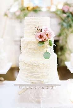 Textured White Cake with Fresh Flowers. A three-tiered textured wedding cake decorated with pink roses, created by Earth and Sugar.