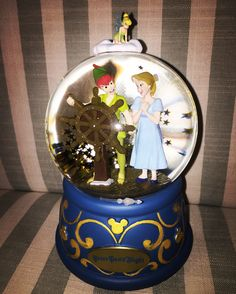Impressive snowglobe featuring the beloved Magic Kingdom attractrion, Peter Pan's Flight. Musical: You Can Fly.