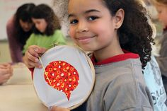 smiling girl with embroidery hoop