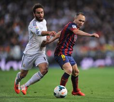 Andres Iniesta of Barcelona is closed down by Daniel Carvajal of Real Madrid during the La Liga match between Real Madrid CF and FC Barcelona at the Bernabeu on March 23, 2014 in Madrid, Spain.